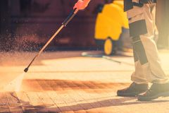 Roadway Brick Cleaning. Residential Roadway Brick Cleaning Using High Pressured Water Stock Image