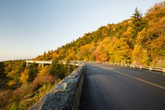 Roadway and bridge in the mountains during fall and fall colors. Roadway and bridge in the mountains during fall and fall color Stock Photography