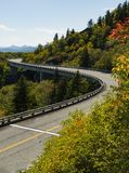 Roadway and bridge in the mountains during fall and fall colors. Scene Royalty Free Stock Photo