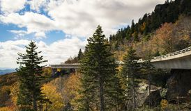 Roadway and bridge in the mountains during fall and fall colors. Scene Royalty Free Stock Photos