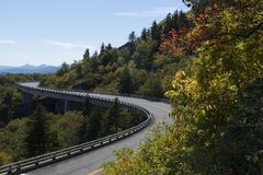 Roadway and bridge in the mountains during fall and fall colors. Scene Royalty Free Stock Photography