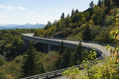 Roadway and bridge in the mountains during fall and fall colors. Scene Stock Photography