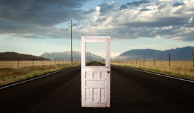 A roadway with a door in the middle of the road royalty free stock photography