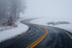 Roadway driving into the fog. On spooky morning in Maryland countryside royalty free stock photos
