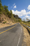 Roadway in El Salvador, Central America. Two lane roadway in El Salvador, Central America, sorrounded by hills Royalty Free Stock Image
