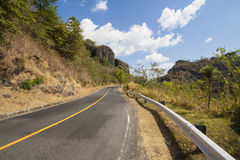 Roadway in El Salvador, Central America. Two lane roadway in El Salvador Central America, sorrounded by hills Stock Image