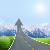 Roadway going up as an arrow in blue sky Royalty Free Stock Images