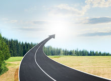 Roadway going up as an arrow in sky Stock Photography