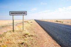 Roadway through Hakskeenpan, Kalahari, South Africa Stock Photos