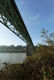 Roadway infrastructure bridge over river waterway. Bridge over waterway, Sellwood Bridge, crossing Willamette River, Portland, Oregon royalty free stock photography