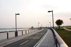 Roadway beside lake Royalty Free Stock Photo