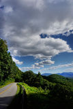 Roadway leading up mountain Stock Image