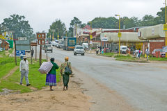 Roadway and local Zulu citizens walking to a Zululand town in South Africa Royalty Free Stock Photo