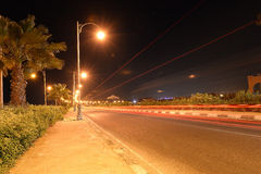 Roadway at night. Illuminated with streetlights and taillight streaks Royalty Free Stock Images
