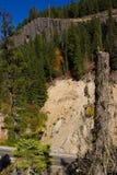 Roadway passing below eroded soil Stock Images