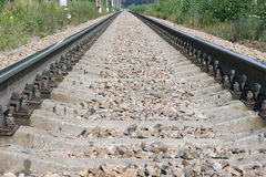 Roadway. Railroad tracks going off to the horizon and converging in perspective Royalty Free Stock Photos