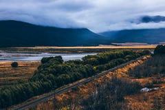 Roadway running away among beautiful terrain royalty free stock image