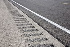 Roadway shoulder rumble strips Stock Image