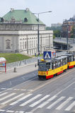 Roadway, tram and a tram stop in the Old Town of Warsaw. Stock Photo