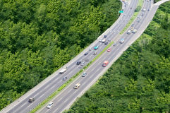 Roadway transportation. Shot of roadway transportation in the center of green forest Royalty Free Stock Photos