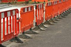 Roadwork barriers. Temporary plastic roadwork barriers keeping vehicle off maintenance area stock photo