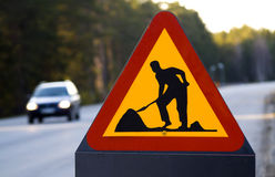 Roadwork sign and car Stock Image