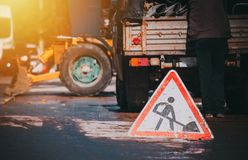 Roadwork sign and process stock photography