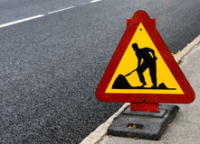 Roadwork sign at the side of a road stock image