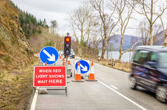 Roadworks Area. Signs and Traffic Lights at a Roadworks area in the countryside of Scotland Stock Photos