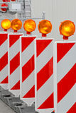 Roadworks barrier. With amber beacon flashing lights Stock Photography
