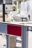 Roadworks. Barrier with construction worker out of focus in background Stock Image
