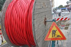 Roadworks and a coil of wire with the road sign Royalty Free Stock Photos