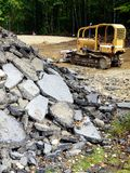 Roadworks: demolished asphalt with grader Royalty Free Stock Photography