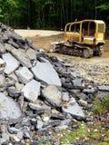 Roadworks: demolished asphalt with grader royalty free stock photography
