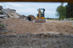 Roadworks. Digger on a site Stock Images