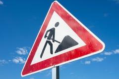Roadworks. German road sign against blue sky: roadworks Stock Photos