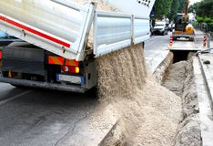Roadworks for the laying of underground cables in the city Stock Image