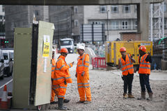 Roadworks near Tower Hill were manual workers are working as a team. They have a break. Stock Photography