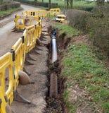 Roadworks in rural road. Roadworks to repair water main in rural road stock photos