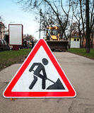 Roadworks sign on the asphalt lane Royalty Free Stock Image
