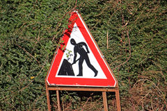 Roadworks sign. In a hedge Stock Image