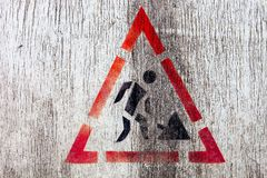Roadworks sign on white painted wooden surface. Stock Photos