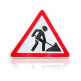 Roadworks, sob o sinal da construção no branco Imagem de Stock Royalty Free