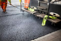 A roadworks on the street new asphalt with worker. S, Road Roller Road Construction Machinery Royalty Free Stock Photography