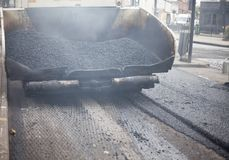 A roadworks on the street new asphalt with worker. S, Road Roller Road Construction Machinery Royalty Free Stock Photo