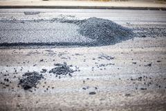 A roadworks on the street new asphalt with worker. S, Road Roller Road Construction Machinery Royalty Free Stock Image