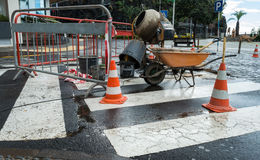 Roadworks in a Town in Madeira. With a wheelbarrow, some traffic cones and a cement mixer Royalty Free Stock Photo