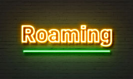 Roaming neon sign on brick wall background. Stock Photography