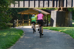 Two Cyclist on the Tinker Creek Greenway. Roanoke County, VA – August 19th: Two Cyclist enjoy a ride on the Tinker Creek Greenway located in Roanoke County Royalty Free Stock Photography
