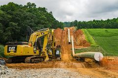 Mountain Valley Pipeline Laying a Gas Pipeline Next to Some Farmland. Roanoke County, Virginia USA – July 21th: Mountain Valley Pipeline MVP laying a gas stock image